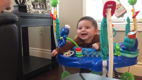 Happy baby can't stop giggling at mommy's antics