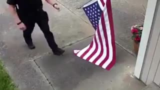 Washington State Cop Rolling Up American Flag - Video
