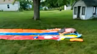 Guy gets knocked out on Slip N' Slide - Video