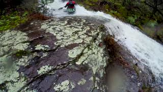 Paddlers insane waterfall ride - Video