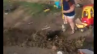 Playful Puppy Helps With Yard Work - Video
