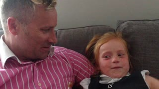 Little girl reacts to Daddy's new hairstyle - Video