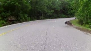 Motorcycle rider loses control during tight turn - Video
