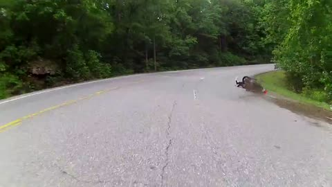 Motorcycle rider loses control during tight turn