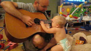 Baby rocks out with dad playing Bon Jovi - Video