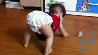Baby engrossed playing - FUNNY BABY VIDEO