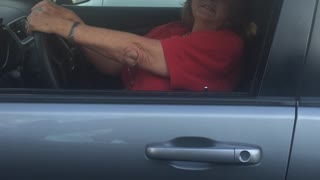 Woman Hits Parked Car In School Parking Lot - Video