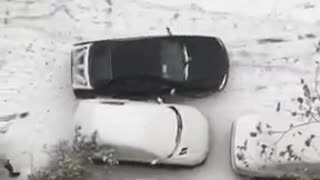 Cars sliding in snow in Tehran - Video
