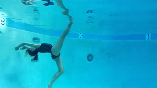 Ballerina performs underwater dance routine