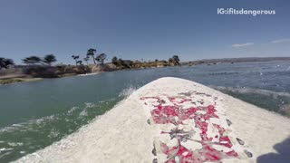 White surfboard guy rides over guy on red surfboard - Video