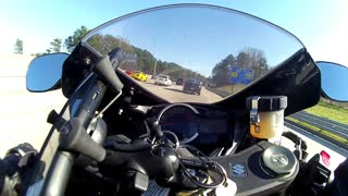 Insane motorcyclist lane splits through heavy traffic