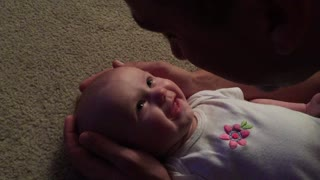 Baby Girl Has Emotional Reaction To Daddy's Singing - Video