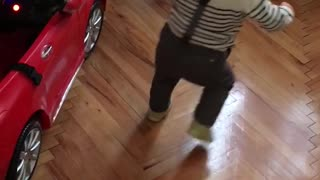 Cute baby getting dizzy performing the spin dance