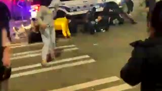 Surrounded by a mob, Tacoma police SUV barrels through crowd, runs over at least one