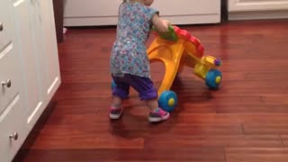 Baby's first time wearing shoes proves to be adorably difficult