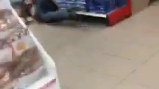 Two girls walking through convenience store girl in brown slips - Video