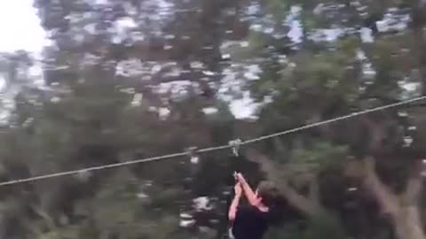 Guy homemade zipline too fast runs into ladder pole at end