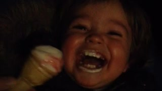 Baby finds eating ice cream hilarious