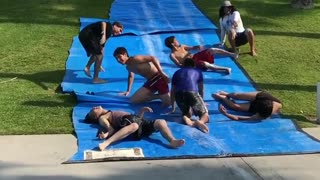 Collab copyright protection - dudes jump over friends slipnslide - Video