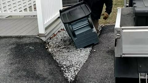 Determined Man Goes To War With Garbage Can During Wind Storm