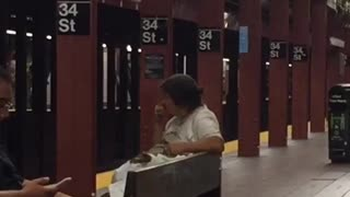 Woman flicks booger on man in NYC subway  - Video