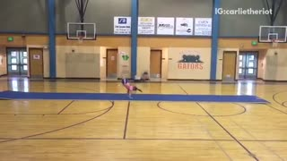 Girl in pink tries to do flips but falls down