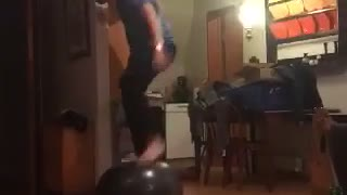 Guy blue shirt on top of ball falls down - Video