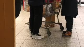 Woman with shopping cart on subway platform