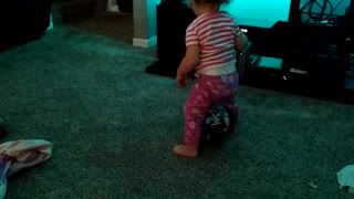 Hysterical toddler tries to sit on ball - Video