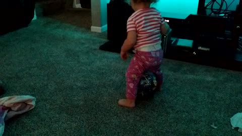 Hysterical toddler tries to sit on ball