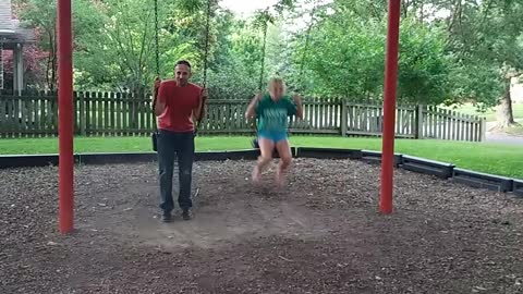 Fun Loving Teen Girl Gets Tangled Up Trying To Jump Off Swing Set