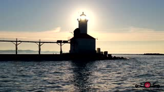 Stunning winter drone footage of Lake Michigan lighthouse