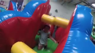 Little girl runs into obstacle in bouncy house, hollaback girl