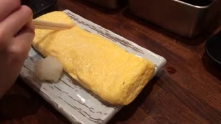 Egg role at Dodonbori  in Osaka - Video