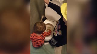 Young Brothers Paint Bathroom Wall With Toilet Water - Video