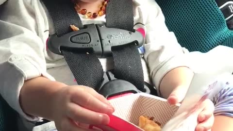 Toddler is in awe over chicken nuggets