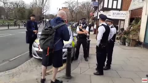 police moving on piers corybn and supporters leafleting out side TURNHAM GREEN STATION