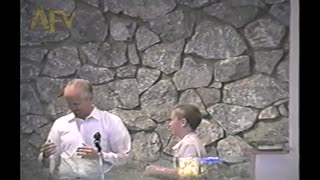 Kid Cannonballs Into Baptismal Water, Priest Dared Him To Do It - Video