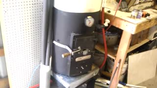 Wood fired domestic hot water heater