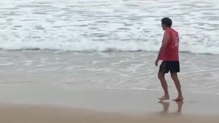 Kid with boogie board gets hit by wave