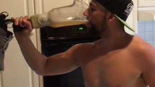 Man in hat drinks beer from prosthetic leg - Video