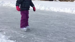 Girl Learning To Ice Skate Says It's Easy While Dad Falls Behind Her - Video