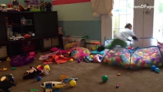 White shirt kid jumps into ball pit hits head on door - Video