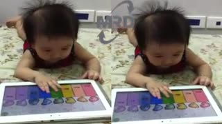 AMAZING BABY PIANO PLAYER - Baby playing the piano on the phone