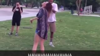 Guy tries to kick water bottle off girls head - Video