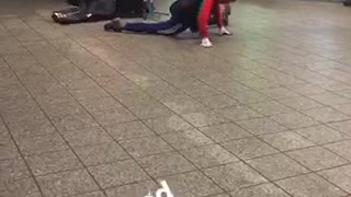 Person in spiderman outfit dances to subway music