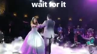 Groom trips during first dance with wife
