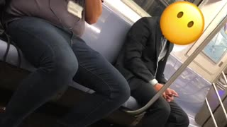 Man on train taking pictures of people - Video