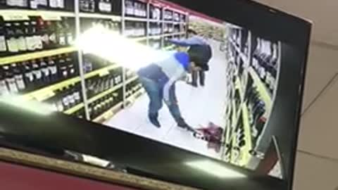 Man drops bottle of wine on security cam
