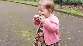 One-year-old girl preciously plays the harmonica - Video